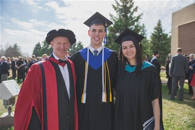 Briercrest College and Seminary college valedictorian Jason Wendel stands with two of Briercrest�s professors, Dr. Wes Olmstead and Johannah Bird, on April 16, 2016.